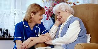 Nurse with carer in chair